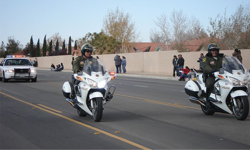 Police Officers riding on motorcycles down a city street